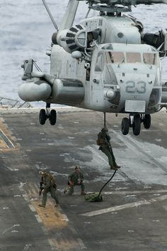 Marines fast-rope from a helicopter. PACIFIC OCEAN (Oct. 5, 2012) Marines assigned to the 15th Marine Expeditionary Unit (15th MEU) fast-rope from a CH-53E Super Sea Stallion helicopter to the flight deck of the amphibious assault ship USS Peleliu (LHA 5