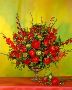 A formal English-style bouquet uses only four types of flowers -- dahlias, gladiolus, bupleurum, and a hybrid aster -- but this result, all in red, is spectacular.