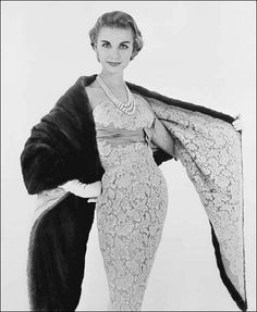 1956    Lace sheath with a mink stole lined with same material.