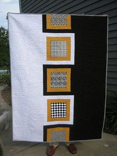 yellow black white quilt.