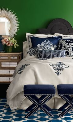Navy blue bedroom  with green wall.