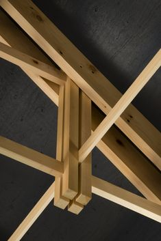 Narrow strips of timber in archery hall roof joinery resembles nocked arrow-KYUDO ARCHERY HALL BY FT ARCHITECTS