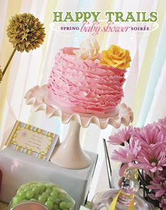 crepe paper backdrop. check out that ruffled cake! http://www.hostessblog.com/2011/06/happy-trails-spring-baby-shower-soiree/
