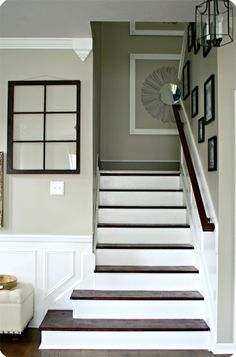 Love, love, love this look! paint banister, put chair rail going up, take down wall - adds more open room....