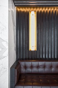 Refined, masculine and modern details | banquette seating | booth design | Beefbar - humbertpoyet