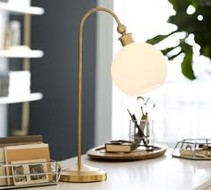 This lamp shines on your bedside with a frosted glass shade and simple curved neck. Bedside Lamp, Desk Lamp, Table Lamp, Pottery Barn Desk, Home Goods Furniture, French Desk, Family Room Design, Frosted Glass, Glass Shades
