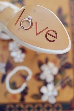 Fun incorporation of the #bride's shoe! Photo by @VanessaJoy RobAdams. #weddingphotography #weddingring