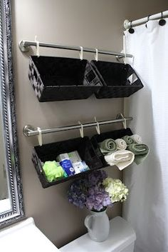 This one of my favorite solutions for small spaces and storage. These are not only great in a bathroom, but great in laundry room, closets for gloves and hats during winter, and craft rooms. I love how you can attache different sizes and colors of baskets to the towel rod to color code things.