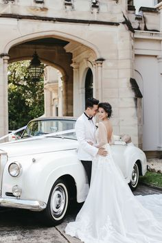 Celebrity bride in a couture WTC Studio gown with illusion lace and a decadent 40-foot train // Taiwanese celebrities Sunny Wang and Dominique Choy's Fairytale Garden Wedding