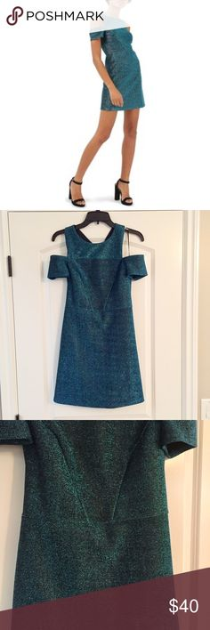 TOPSHOP Blue Shiny Dress TOPSHOP Blue Shiny Dress perfect for a night out! Brand new with tags. 87% polyester, 9% elastane, 4% metallised. Color is bluefish/greenish. Topshop Dresses Mini