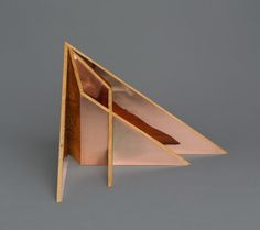 """Designer Aljoud Lootah, made this furniture collection called """"Oru"""" (meaning """"fold"""" in Japanese). Great use of copper."""