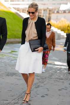 Simple and elegant in white skirt, nude pleated blouse, black cardi_Outside Haider Ackermann #StreetStyle