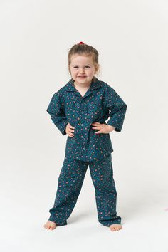 Keep your little one cosy this winter with this snug pyjama sewing pattern. The top features a notched collar, button front and chest pocket, while the bottoms are straight-legged with an elasticated waist for comfort. Best sewn in breathable cottons, the Pomegranate Pyjamas are an Advanced Beginner/Intermediate level pattern, although a beginner could confidently sew up the bottoms. They make the cutest Christmas gift for kids too! Who Is Poppy, Pjs, Pajamas, Childrens Pyjamas, Sew Over It, Cute Christmas Gifts, Handmade Clothes, Pomegranate, 6 Years