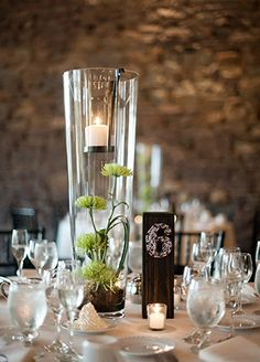 Cool Wedding Centerpieces That You Can Keep Long After The Wedding Is Over:  #2. Tall Protea Terrarium