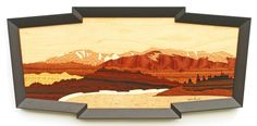 """Pikes Peak and Crystal Creek Reservoir Panorama. The reservoir can be seen from Pikes Peak Highway near Mile Marker 6. The woods used in this scene are: Figured Wite Ash, Planetree, Quilted Moabi,English Sycamore, Koa, African Satinwood, Brazilian Rosewood, Macassar Ebony, Sapele Pommele and Red Oak. Size: 13"""" x 27"""" - $700."""