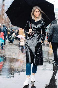 Black vinyl raincoat - definitely a must. Paris fashion week street style.