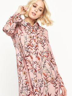 Glamorous Printed Shirt Dress In soft pink with autumnal coloured floral prints, this shirt dress by Glamorous was made for this season. Full sleeves, smart collar and short hemline fuse the masculine classic with more feminine overtones, while the shape has a subtle swing style about it creating a gorgeous silhouette.Ankle boots are a must when it comes to styling this shirt dress!Washing Instructions: Machine Washable