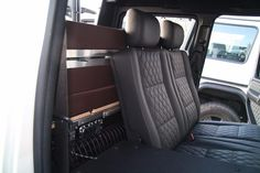 During travel, the bed folds up to allow use of the back seats