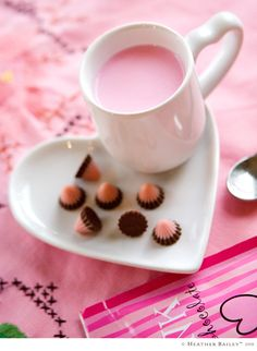 Cost Plus World Market is selling pink hot cocoa for Valentine's Day in pink-striped packages.  Might make for some fun grown-up valentines?? These little strawberry/chocolate bits are from there too.  The mini mug set is from Target.