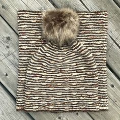 """A versatile unisex hat and cowl pair, this pattern is great for showing off lovely hand-dyed yarn. The little short row """"blips"""" remind me of a horse stepping high over cavaletti poles and are fun to knit once you get going. The set is knit entirely in garter stitch and it's written so you do not have to purl any rounds, using a way I developed with an overlapping stitch. Feel free to use your preferred method or to purl every other round if you like that sort of thing."""