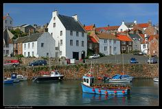 Photo of harbour-side whitewash houses in the village of Crail in East Neuk of Fife, on the east coast of Scotland. Fife Scotland, Places In Scotland, Scotland Travel, Places To Travel, Places To Go, Scotland Holidays, Country Scenes, Scottish Highlands, Scottish Kilts
