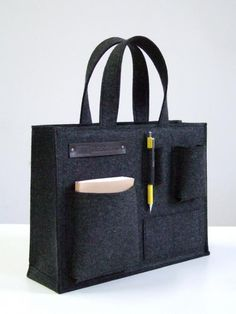 """This bag was designed with a concept of """"carrying your desktop"""". $220"""