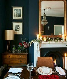 Deep blue walls in littlegreenepaintcompany's Basalt Absolute Matt Emulsion make a good foil for brown furniture, adding a refreshing twist to a traditional table setting. diningroom fireplace interior Photograph Jonathan Gooch, design by Emma Collins Home Living Room, Living Room Designs, Dark Walls Living Room, Colour Schemes For Living Room, Dark Wood Furniture Living Room, Color Schemes, Dark Rooms, Apartment Living, Sweet Home