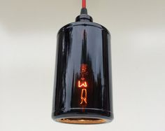 Made from a repurposed Captain Morgan bottle.  Includes hardware to attach to most ceiling receptacles.  Length options will be from ceiling to bottom of light fixture.  Uses candelabra style bulb - not included.
