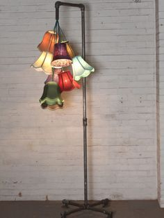 Conduit floor lamp with assorted floral shades