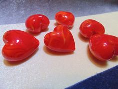 CHEAPLY PRICED. $1.75 Canadian each. Lampwork glass heart beads.  Beads are puff hearts which means they are three dimensional.  Heart beads measure 30 X 25mm.  Can be used in stringing projects for making necklaces, earrings, bracelets and any other jewellery or craft project.  (PLEASE NOTE: This item does not qualify for free necklace with purchase offer.). https://www.etsy.com/ca/shop/JehovahJJewellery?ref=si_shop