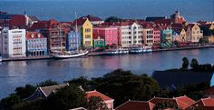 Curacao has been named 'Favorite Caribbean Destination' by About.com readers. This photo captures the colorful Handelskade in Willemstad, Curacao. http://www.beachmaniac.com/caribbean/curacao-favorite-destination/