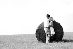 this would be perfect -- something in a field with hay. its such a huge part of us. not even close to being engaged but its so fun to day dream!