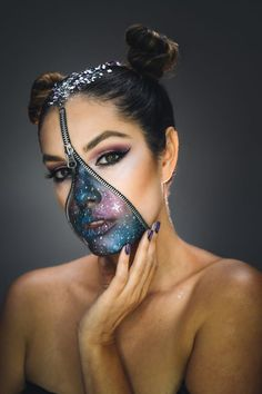 Mesmerize people with this epic galactic makeup look! Materials needed: Face paint Zipper Face glue Glitter stars & confetti Directions: Start by gluing the zipper in the center of face as shown in the video. Paint the nose and around the mouth black. Layer with galaxy colors of choice – a mix of blue and …