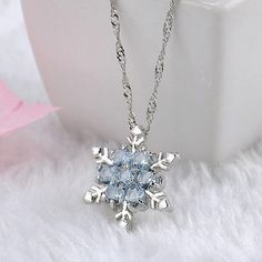 CRYSTAL SNOWFLAKE NECKLACE A high quality necklace with a beautiful crystal snowflake pendant. Silver Pendant Necklace, Crystal Pendant, Silver Necklaces, Crystal Necklace, Pendant Jewelry, Silver Jewelry, Diamond Necklaces, Flower Necklace, Flower Pendant