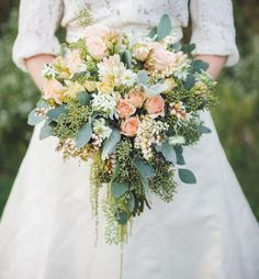 Wedding Bouquet Featuring Several Varieties Of Roses, Tuberose, Andromeda, Dusty Miller, Green Seeded Eucalyptus + Other Varieties Of Greenery & Foliage
