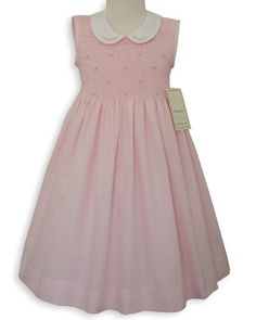 Absolutely beautiful! This pink sleeveless dress is created in pique 100% cotton, with heavy smocking in the bodice, the embroidered flowers in the piped Peter Pan Collar and smocking are done in pale