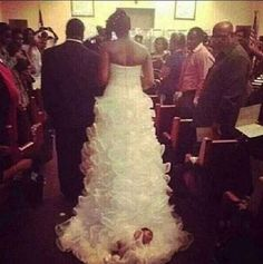 A Bride Actually Tied Her Baby To Her Wedding Dress Train And Dragged Her Down The Aisle. WTF?!