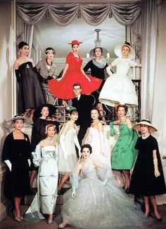 Yves Saint Laurent, the new head of Maison Dior, surrounded by house models wearing his designs, 1958.