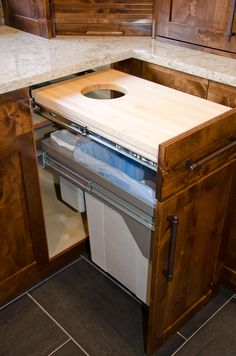Drawer cutting board with compost hole and recycle bin storage