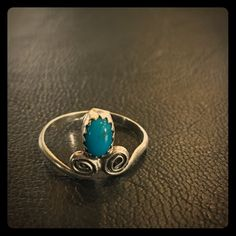 """Vintage Sterling Silver Turquoise Ring Vintage Sterling silver & turquoise ring. Size 6. Signed """"Sterling"""", but most of the hallmark is worn off. Excellent condition with minimal signs of wear. Unique, cute design. Jewelry Rings"""