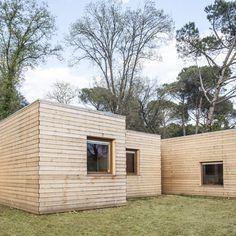 Casa GG by Alventosa Morell Arquitectes comprises timber-clad volumes