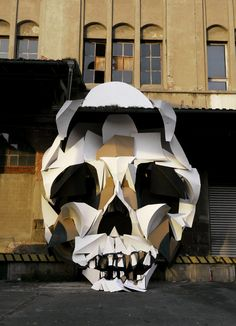 Amazing cardboard sculpture outside an abandoned warehouse by Clemens Behr