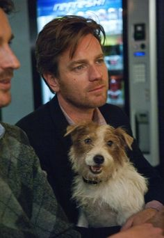 ewan mcgregor holding a puppy and looking adorable