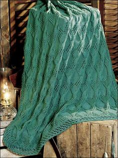 Our gorgeous Ebb Tide knit afghan combines lace, reverse stockinette, and large cable stitches to create a beautifully textured afghan.  Download the free pattern at freepatterns.com.