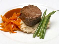 Filet Mignon over Lobster Boursin Mashed Potatoes with a Merlot Reduction recipe from Robert Irvine via Food Network