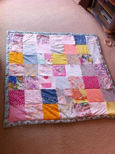A quilt made from baby clothes from babies first year. Just lovely!