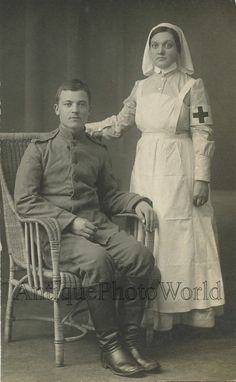 Russian soldier with young Red Cross nurse in uniform