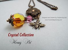 Brass Necklace with Ball Chain - Accented with Swarovski 19mm Copper Chessboard Crystal Bead with square cut facets and Swarovski 8mm Rose Round Bead. Also includes a flower and bee charm. This bee loves the flower and the honey! Warm honey shades radiate from this exquisite piece! Bold and beautiful, this copper crystal casts a charming and radiant spell. Visit my Etsy shop at www.TouchedByGod.etsy.com!