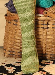 Bold, eye-catching cables: the Trellis and Coin Sock by Maureen Foulds.