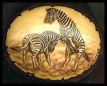 'Zebra Fighting' - This is burnt on the sanded face of a whole tagua nut. Pyrography and white acrylic paint. Sold.